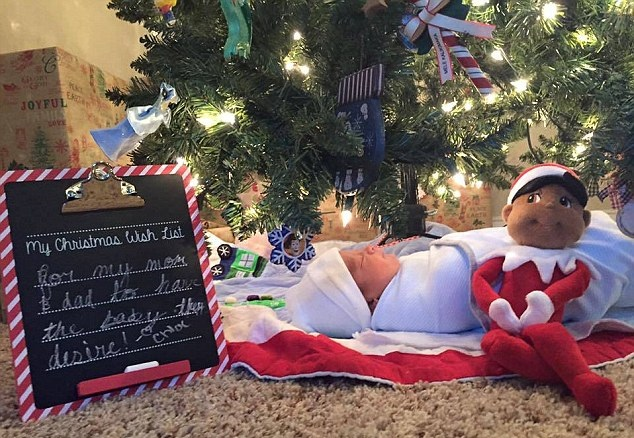 Choe's Christmas wish for a new baby sits next to her new brother under the Christmas tree.